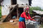 Woman washing cooking utensils