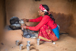 Woman making tea for her family