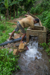 Farmer cleaning the channel of Timur Sein multipurpose irrigation project
