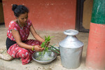 Washing vegetables to prepare meals