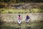 Farmer speaking into recorder during interview in her wetland plot, Craigieburn