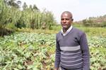 Urban farmer Fuje Sebani stands in his plot