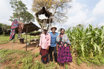 Farmers in their field near the tree house