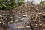 Excreating Lechate from waste piles removed from Biogas tanks at Dickowita