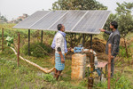 Instructing farmers how to keep solar panels cleaned