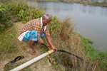 Farmer pumping groundwater with electricity generated by solar panels