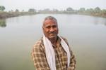 Farmer near a lake