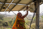 Woman connecting the solar panels to