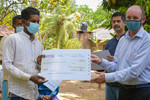 Farmers receiving their first insurance payout at a ceremony held in the village of Galenbindunuwewa