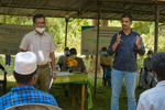 IWMIs Mohammed Aheeyar and Giriraj Amarnath speaking at the insurance payout ceremony held in the village of Galenbindunuwewa