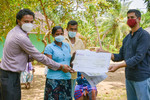 IWMI and Sansa representatives handing over insurance payout to farmers