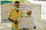A farmer family in Sri Lanka who received their first insurance payout